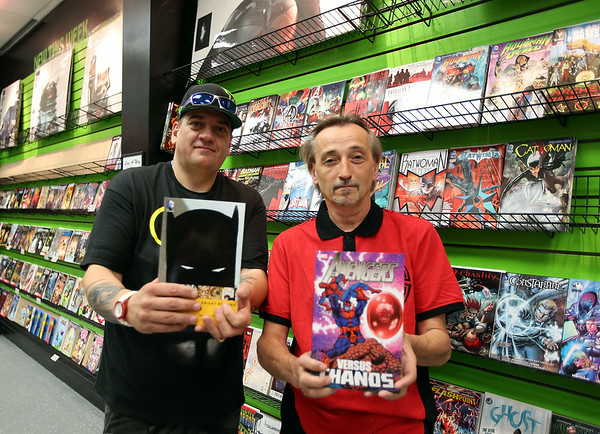 Silver Moon Comics partners William Choquette, left, and Chris Berry, right, proudly display a few brand new comic books. Silver Moon is Salem's second comic book store and shows a resurgence in the interest in the genre. DAVID LE/Staff photo. 8/20/14