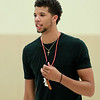 Michael Carter-Williams, a Hamilton native and 2014 NBA Rookie of the Year, referees a scrimmage during the MCW Basketball Camp held at Ipswich High School over a three-day span. DAVID LE/Staff photo. 8/14/14.