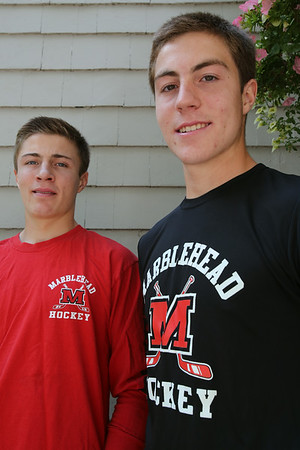 KEN YUSZKUS/Staff photo. Twin brothers and hockey standouts Matt, left, and Kyle Koopman of Marblehead are transferring to the Berkshire School . 8/4/14