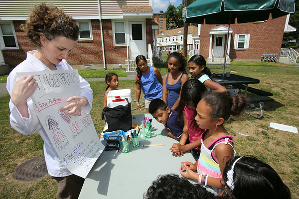 "KEN YUSZKUS/Staff photo. Holly Kohler speaks about various fingerprints during the Salem YMCA program ""Science from Scientists"" at the Rainbow Terrace Housing Development in Salem. 8/15/14"