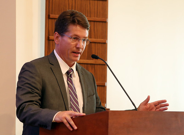 Democratic congressional candidate John Devine makes his opening remarks during a Congressional Forum at Brooksby Village along with candidates Seth Moulton, Marise DeFranco, John Gutta, and Congressman John Tierney. DAVID LE/Staff photo. 8/27/14.