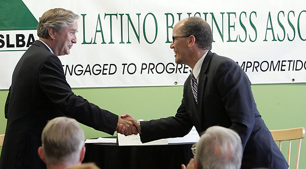 KEN YUSZKUS/Staff photo. Congressman John Tierney shakes hands with U.S. Labor Secretary Tom Perez as Perez was introduced to make his speech at the North Shore Latino Business Association in Lynn.  8/6/14