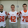 From left: Beverly Football Players Daniel Iraola (68), Ben Schlegel (42), Kyle Gahan (70). DAVID LE/Staff photo. 8/22/14.