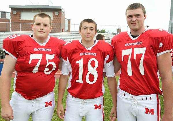 From left: Masconomet Regional High School Seniors Kyle Taggart (75), Roby Deschenes (18), Jack Butt (77). DAVID LE/Staff photo. 8/22/14.