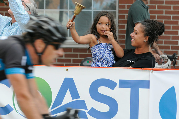 PAUL BILODEAUS/Staff photo.   Makaylla Irving with her daughter, Tatiana, 5, who got a chance to ring a bell signaling a prize during the Gran Prix of Beverly held last night downtown Beverly. 7/30/14
