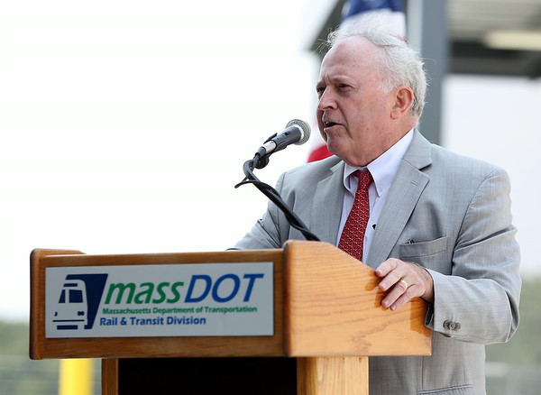 Former Beverly Mayor Bill Scanlon makes a few remarks during a ribbon cutting ceremony to officially open the new Beverly Depot Parking Garage on Friday afternoon. DAVID LE/Staff photo. 8/1/14.