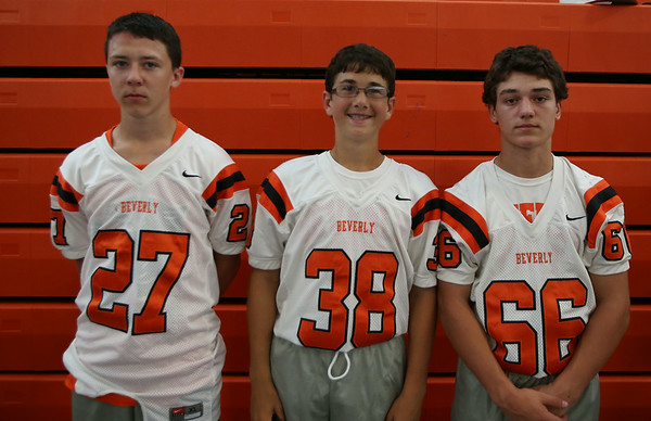 From left: Beverly Football Players Chris Cole (27), Adam Ellis (38), Trenton Weaver (66). DAVID LE/Staff photo. 8/22/14.