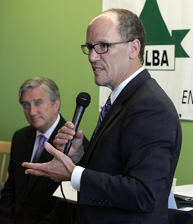KEN YUSZKUS/Staff photo. Congressman John Tierney listens to U.S. Labor Secretary Tom Perez as he speaks to the North Shore Latino Business Association in Lynn.  8/6/14