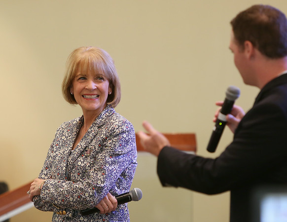 Martha Coakley, who will be running for Governor of Massachusetts, flashes a wide smile while being introduced prior to speaking with residents at Brooksby Village in Peabody on Friday morning. DAVID LE/Staff photo. 8/22/14.