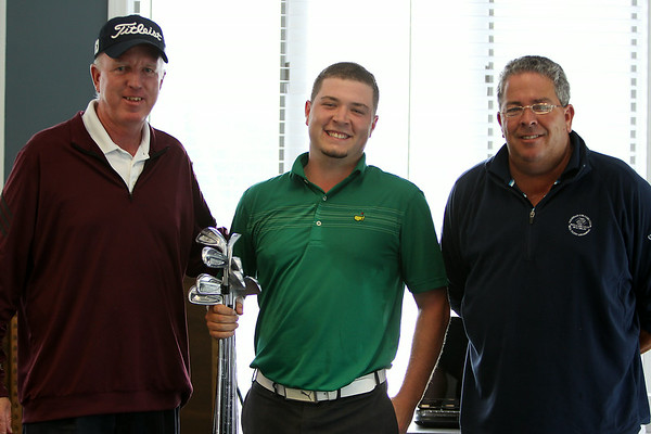 Winner of the 2014 North Shore Amateur Open Nick Maccario, center, stands with Golf Pro John O'Connor, left, and Director of Golf Bob Flynn, right, while holding the victory clubs. DAVID LE/Staff photo. 8/13/14.