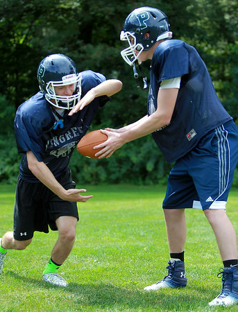 Pingree senior captain and running back Sal Fazio, left, takes a handoff from junior quarterback Griffin Beal. DAVID LE/Staff photo. 8/21/14.