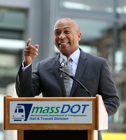 Governor Deval Patrick smiles while speaking at a ribbon cutting ceremony to officially open the new Beverly Depot Parking Garage on Friday afternoon. DAVID LE/Staff photo. 8/1/14.