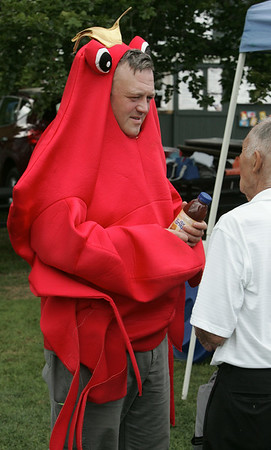 KEN YUSZKUS/Staff photo. Kenneth Glover wears a king crab costume while walking around the Beverly Homecoming Lobster Festival at lynch Park.  8/6/14