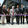 From left: State Representative Jerry Parisella, former State Representative Mary Grant, Beverly Scott, GM and Chief Executive Officer of the MBTA, former Beverly Mayor Bill Scanlon, Governor Deval Patrick, Beverly Mayor Mike Cahill, and Project Manager for the MBTA George Doherty, line up for a ribbon cutting to officially open the new Beverly Depot Parking Garage on Friday afternoon. DAVID LE/Staff photo. 8/1/14.