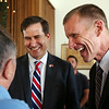 KEN YUSZKUS/Staff photo. Seth Moulton, left, and General Stanley McChrystal laugh with a supporter at the Peabody-Lynn Elks Lodge. General Stanley McChrystal endorsed Seth Moulton for congress at the event. 8/4/14