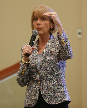 Martha Coakley, who will be running for Governor of Massachusetts, speaks with residents at Brooksby Village in Peabody on Friday morning. DAVID LE/Staff photo. 8/22/14.