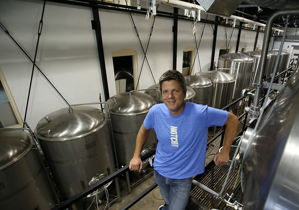 Salem native Chris Lohring is the founder of Notch Brewery Company and is planning on building a brewery and moving his company into Salem. Lohring and Notch currently brew their beer inside the Ipswich Ale Brewery. DAVID LE/Staff photo. 8/1/14.