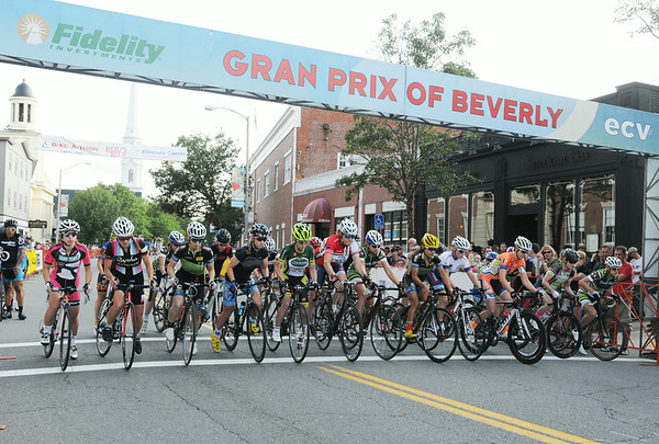 PAUL BILODEAUS/Staff photo.   The woman's race get underway during the Gran Prix of Beverly held last night downtown Beverly. 7/30/14