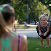 Three-year-old Isabella Crotty, of Danvers, smiles as she is pushed on one of the swing sets at Plains Park by her mother Stephanie Serino, on Tuesday evening. DAVID LE/Staff photo. 8/26/14.