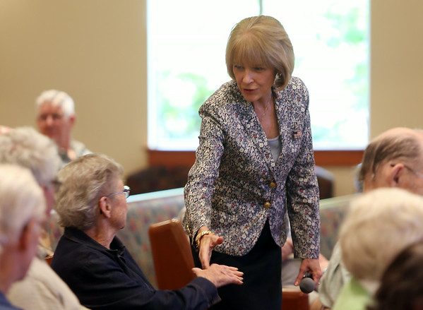 Martha Coakley, who will be running for Governor of Massachusetts, shakes hands with residents at Brooksby Village as she is introduced in Peabody on Friday morning. DAVID LE/Staff photo. 8/22/14.