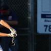 DAVID LE/Staff photo. Danvers catcher Adam Bidgeo lines a hit against Lynn. 8/14/15.