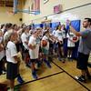 KEN YUSZKUS/Staff photo.  Bishop Fenwick's girls varsity basketball coach Adam DeBaggis discusses game strategy during the basketball camp held at the school.    8/14/15