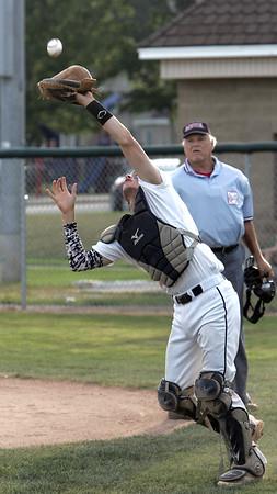 KEN YUSZKUS/Staff photo.  Danvers' catcher Tim Unczur catches a pop fly near home plate during the Newburyport at Danvers Senior Babe Ruth baseball playoffs.    8/3/15