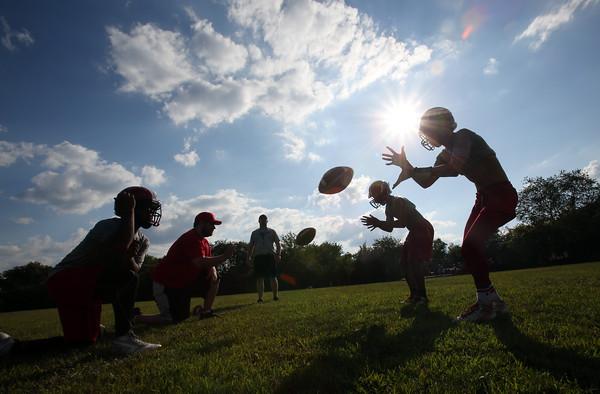 DAVID LE/Staff photo. Salem quarterbacks run through drills on Wednesday. 8/26/15.