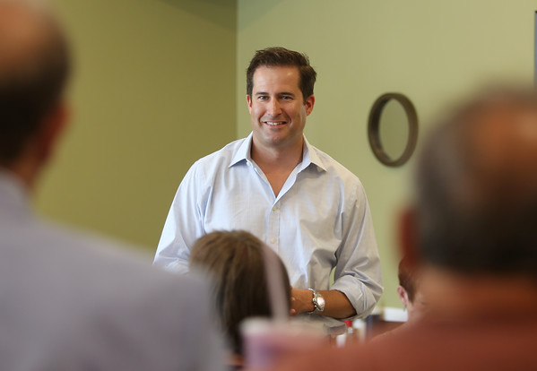 DAVID LE/Staff photo. Congressman Seth Moulton made a visit to a crowded Harbor Cafe in Danvers on Wednesday afternoon to greet and talk with local residents. 8/19/15.
