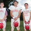 Aubrey Leake, John Paikos, and Cam Vailencourt pose during football practice Thursday, Aug. 27, at Masconomet High School.