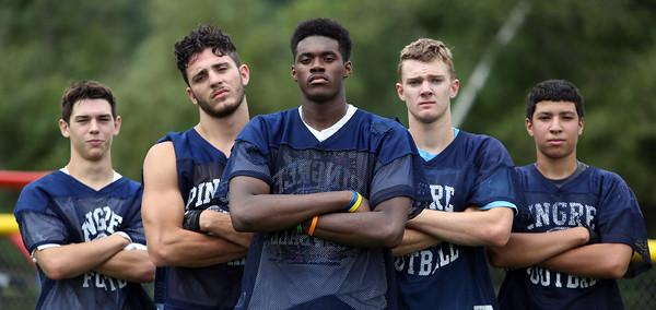 DAVID LE/Staff photo. From left: The Pingree wide receiver corp includes senior Nate Rawlins, senior Justin Assad, junior Alonzo Jackson, junior Jackson Latimer, and senior Hadi Hamden. 8/25/15.