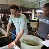 DAVID LE/Staff photo. Redemption Fish Company co-owner Colin Davis.  8/28/15.