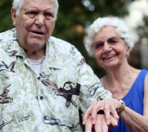 DAVID LE/Staff photo. Beverly residents Joseph and Elaine Carron recently lost Elaine's wedding ring. The ring was returned to the Beverly Police Department and they managed to find out who the ring belonged to and returned it just after the couple's 60th anniversary. 8/16/16.