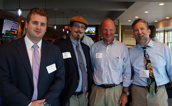 DAVID LE/Staff photo. From left, John O'Keeffe, of Cristo Rey High School, Andrew Kolar, of Fused Studios Larry Albert, of Capital Management, and Paul Mervis, of Encore Images, at the North Shore Chamber of Commerce's networking event held at Sea Level in Salem on Thursday evening. 8/18/16.
