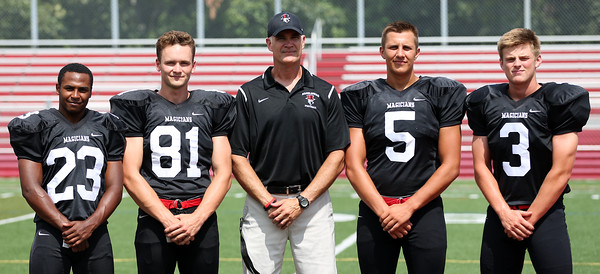 DAVID LE/Staff photo. Marblehead 2016 senior captains Jaason Lopez, Manning Sears, Harry Craig, and Bo Millett and head coach Jim Rudloff will be looking to make a deep playoff run once again in 2016. 8/26/16.