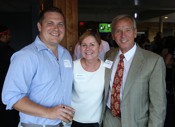 DAVID LE/Staff photo. Jeff Rolke, of GoldCoast Mortgage, Abby Grant, of the Enterprise Center, and Dan Durant, of Equitable Bank, at the North Shore Chamber of Commerce's networking event held at Sea Level in Salem on Thursday evening. 8/18/16.