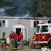 DAVID LE/Staff photo. Firefighters from multiple towns reported to a large house fire at 30 Kinsman Lane on Friday afternoon. 8/12/16.
