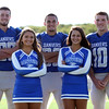 DAVID LE/Staff photo. Danvers Falcons senior football captains Kieran Moriarty, Quin Holland, and Matt Andreas with senior cheerleading captains Megan Walters and Haley McStay. 8/30/16.