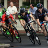 DAVID LE/Staff photo. Racers in the Men's Elite field take a tight turn onto Washington Square West during the annual Witches Cup on Wednesday evening. 8/10/16.