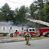 DAVID LE/Staff photo. A fire at 30 Kinsman Lane in Topsfield ripped through the right side of the house on Friday afternoon. 8/12/16.