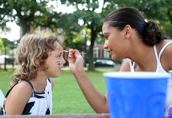 DAVID LE/Staff photo. Six-year-old Mary Reed, of Salem, gets her face painted by Catherine Lake on Friday afternoon at Kid's Night as part of the Heritage Festival at Salem Common. 8/12/16.