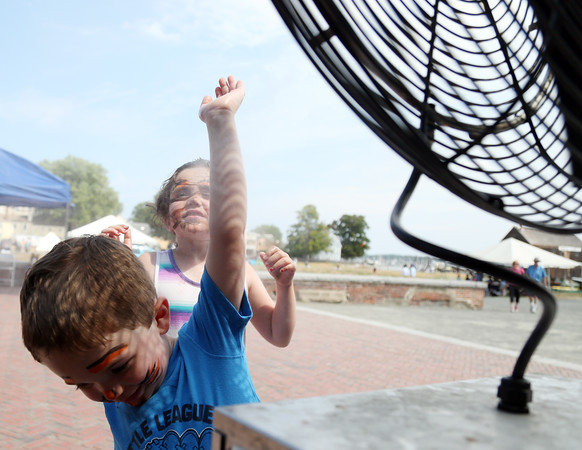 DAVID LE/Staff photo. Nate Harrington, 4, and his seven-year-old sister Gwen, of Salem, cool off in a misting fan sitting outside the Salem Visitor's Center on a hot Saturday. 8/7/16.