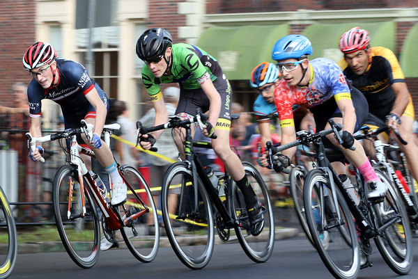 DAVID LE/Staff photo. A large field of Elite Men's racers speed down Washington Square West during the annual Witches Cup on Wednesday evening. 8/10/16.