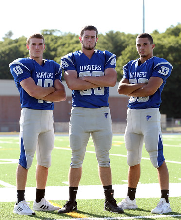 DAVID LE/Staff photo. Danvers senior captains Matt Andreas, Kieran Moriarty, and Quin Holland will lead the Falcons in 2016. 8/30/16.