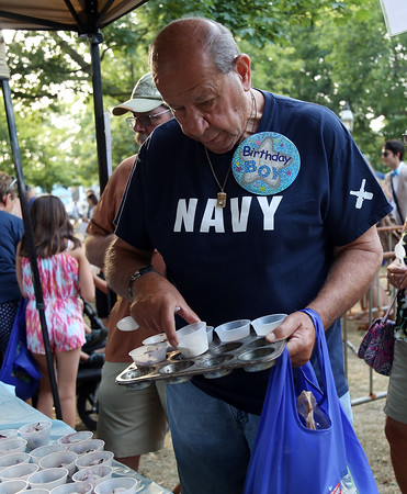 DAVID LE/Staff photo. Eli Schiff, of Beverly, who turned 82 on Tuesday, picks out a selection of ice cream samples on Tuesday evening. 8/9/16.