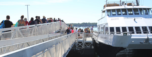 KEN YUSZKUS/Staff photo.  People board the Salem Ferry headed to Boston.   08/03/16