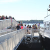 KEN YUSZKUS/Staff photo.  People board the Salem Ferry headed to Boston.   08/03/16