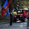 DAVID LE/Staff photo. Col. Gary West, right, salutes the Lynn English High School color guard, left, on his Patriots Honor Ride from Maine to Florida. 8/7/16.