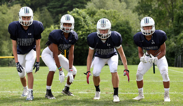 DAVID LE/Staff photo. The Pingree defensive back starting four include  senior Ryan Giunta, sophomore Charlie Nowell, senior captain Jackson Latimer, and sophomore Mike Pisanelli. 8/25/16.