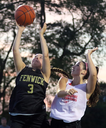DAVID LE/Staff photo. Bishop Fenwick's Sam Gulla (3) tries to convert a layup while being hassled by Masco's Andrea Faia, right. 8/9/16.